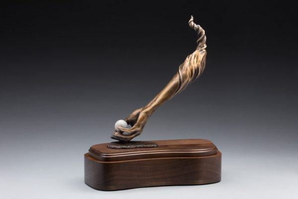 side view of bronze golf sculpture hand holding golf ball cremation urn funeral memorial