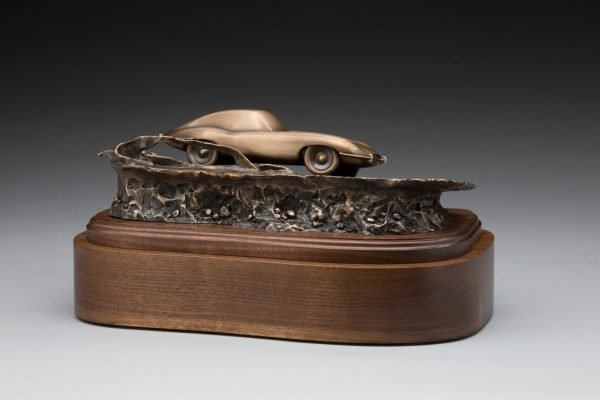 back view of bronze jaguar xke e-type inspired sculpture classic car cremation urn funeral memorial