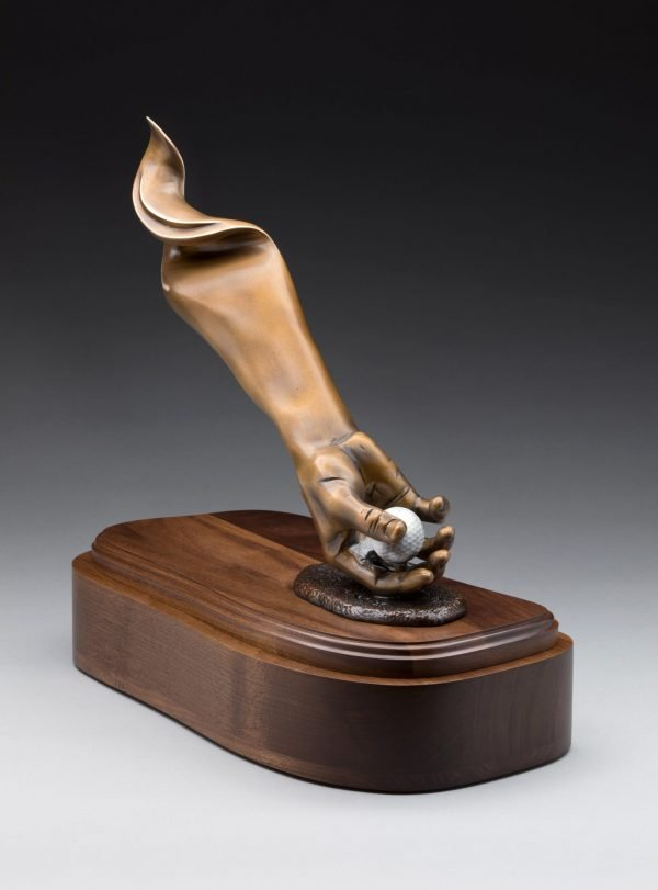 End view of bronze golf cremation urn funeral memorial hand holding ball